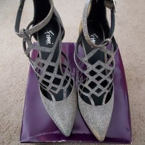 Sparkly silver heels with cute design